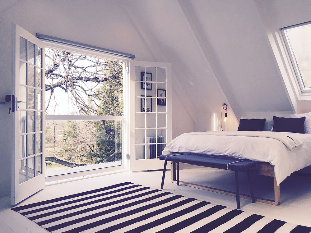 Main bedroom with French doors and juliette balcony