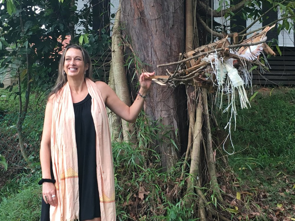 "Artist-writer Lucy Davis next to an assemblage that was part of an exhibition called ""Railtrack Songmaps"" during the M1 Singapore Fringe Festival at Gillman Barracks in January 2016, more recently ""re-wilded"" along the former KTM Malaysian railway Singapore. Photo taken near her Wilton Close residence, Singapore, by Michael Lee."