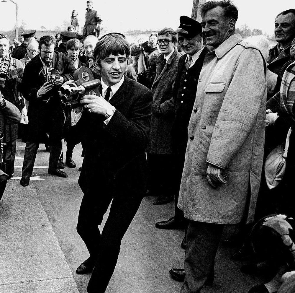 Ringo filming fans and press, 1964
