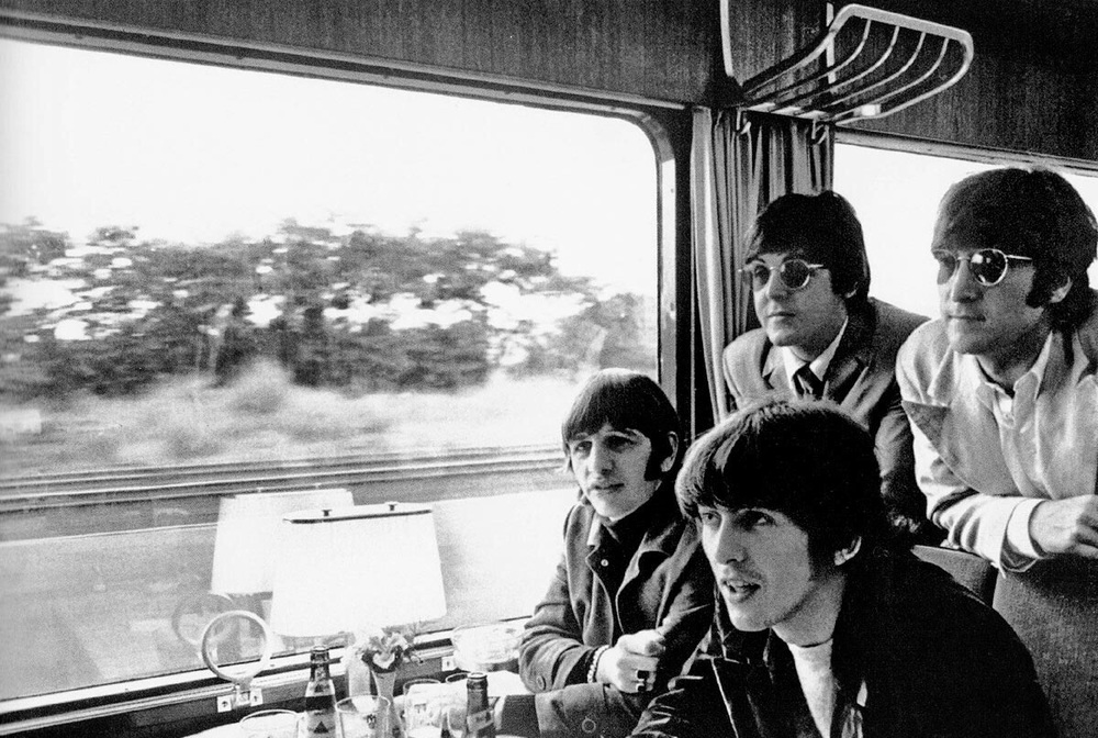 The Beatles travelIng by train in Germany, June 1966