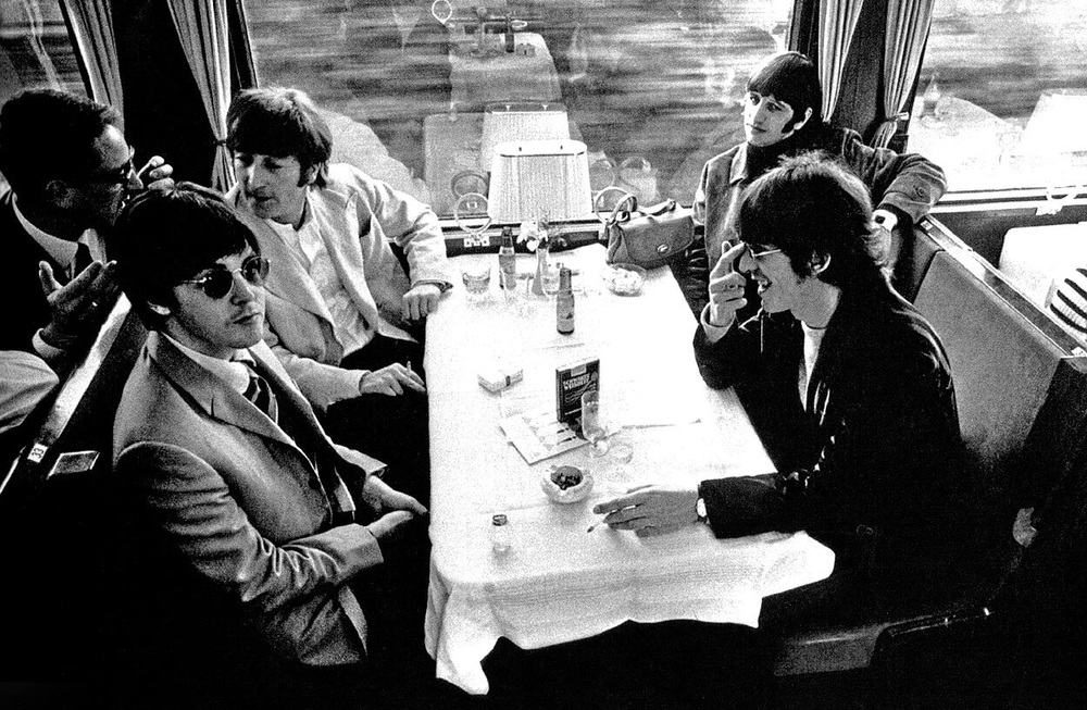 June, 1966, the Beatles en route to their next show in Germany.
