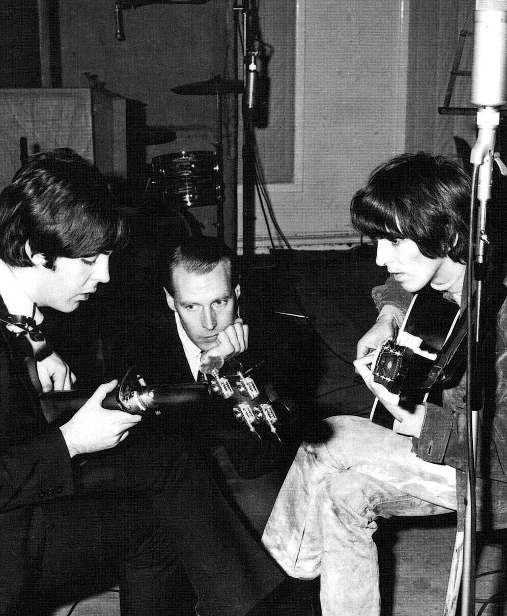 Paul McCartney with George Harrison and producer George Martin, October 1965.