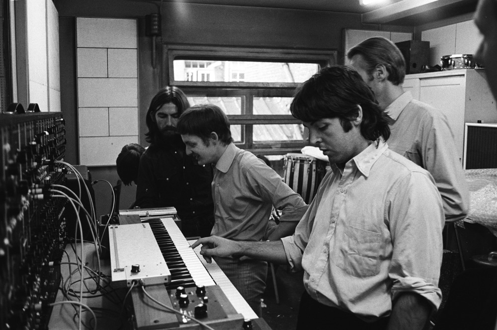 Paul McCartney, George Harrison and George Martin at Abbey Road, 1969.