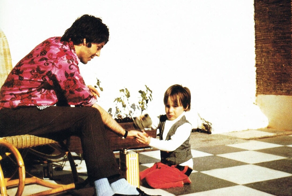 Paul McCartney with Julian Lennon, circa 1968.
