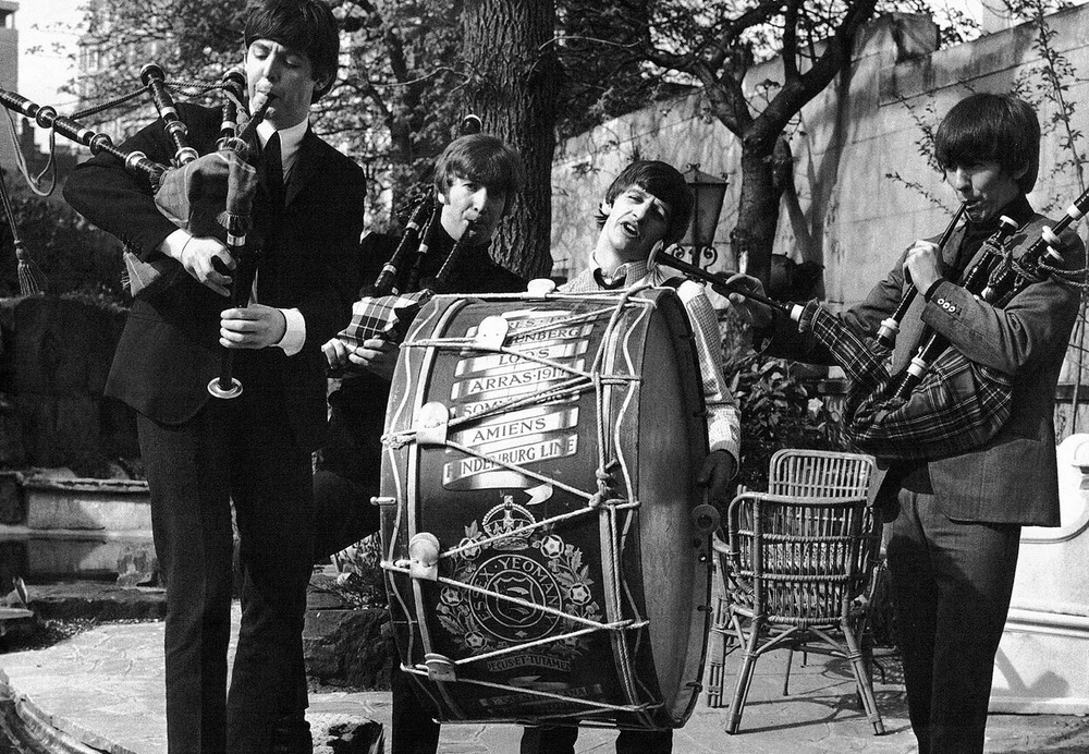 The Beatles playing various instruments in Scotland, 1964.
