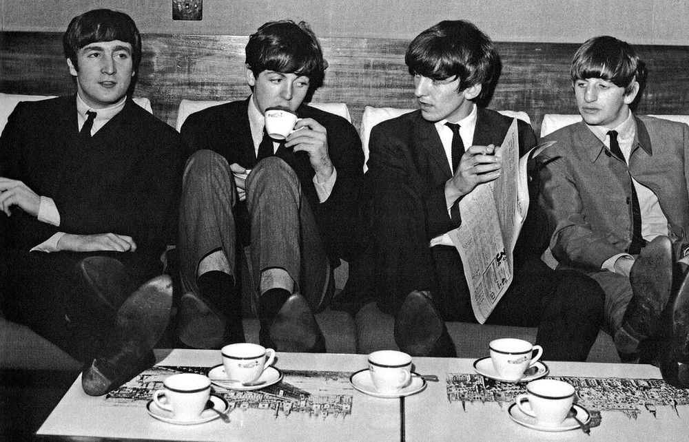 The Beatles enjoying a cup of tea, circa 1964.