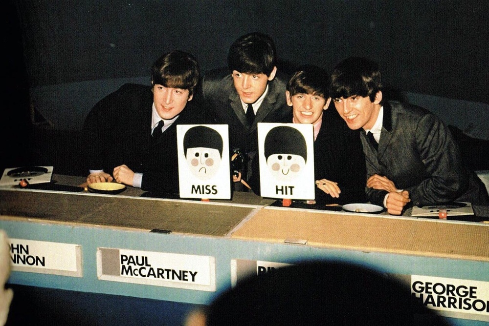 The Beatles make an appearance on the music panel show 'Juke Box Jury', December 1963.