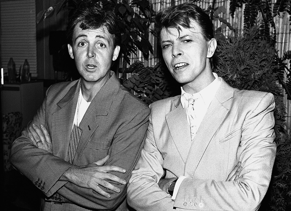 Paul McCartney backstage at Live Aid with David Bowie, July 1985.