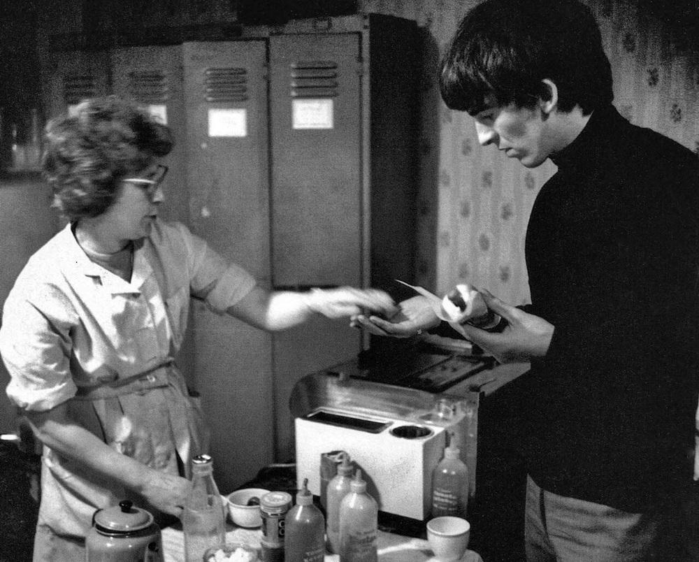 George Harrison purchasing a hotdog, circa 1964.