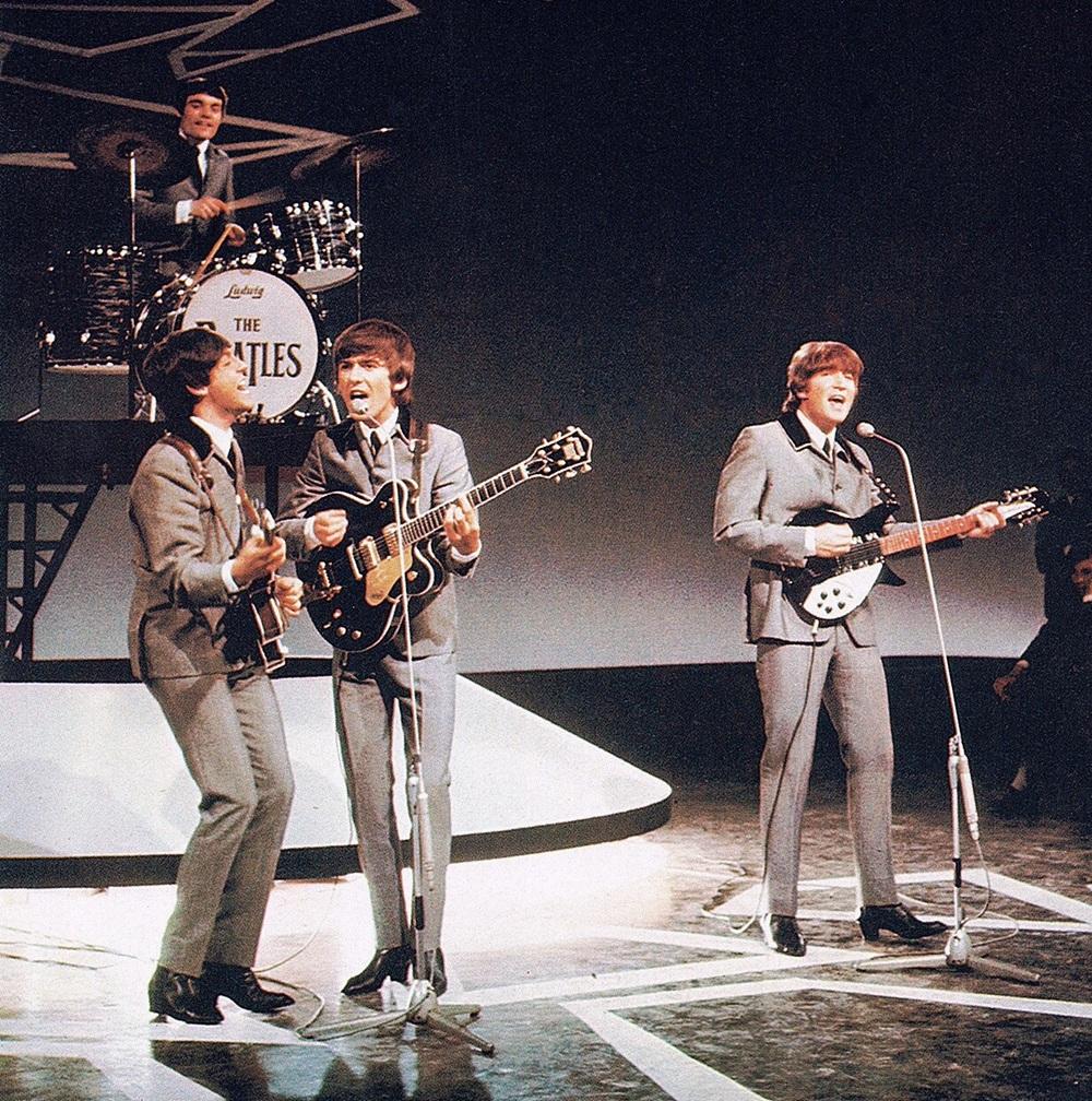 The Beatles live circa 1964.