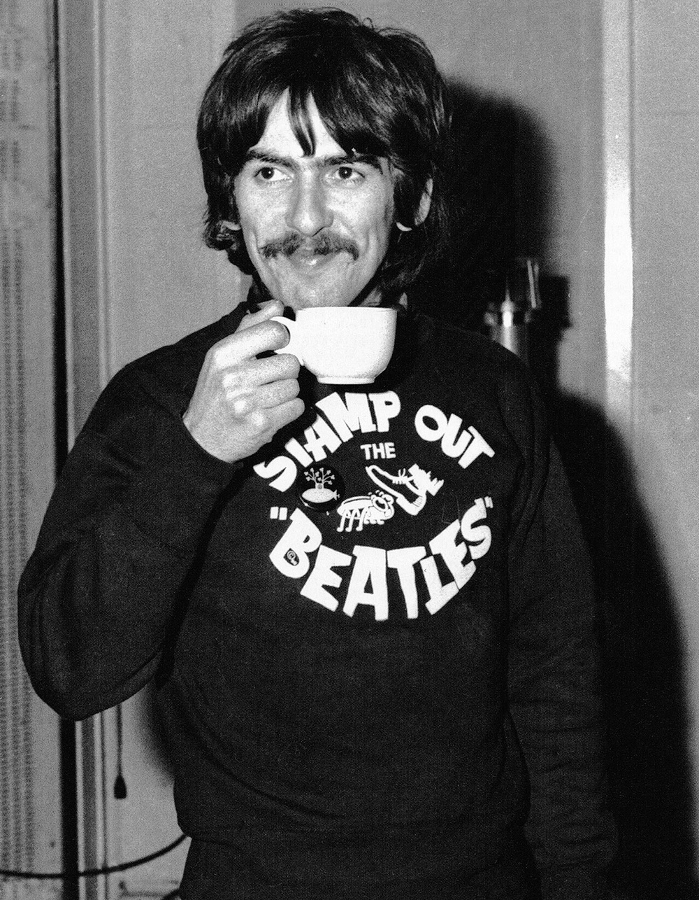 George Harrison wearing a 'Stamp out the Beatles' t-shirt, circa 1967.