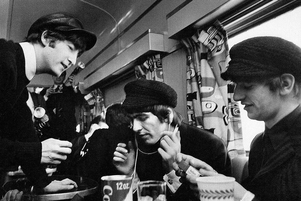 The Beatles on a train, circa 1964.