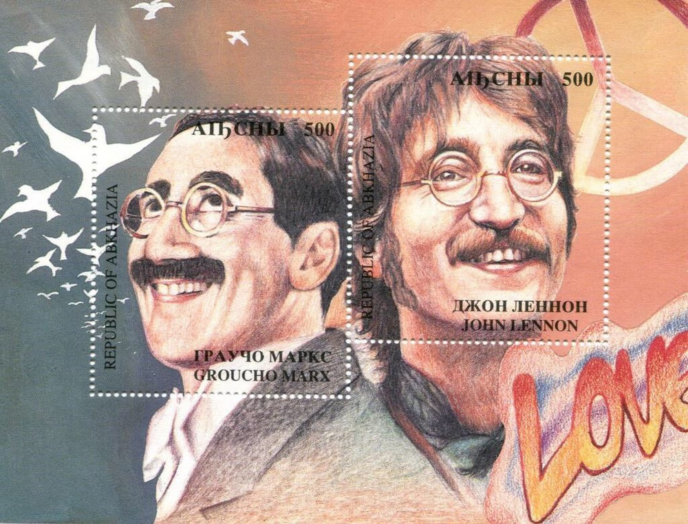 Groucho Marx and John Lennon on a 1994 postage stamp.