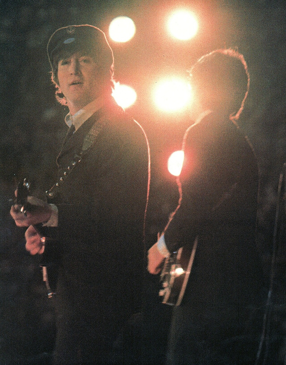 John Lennon and Paul McCartney performing in Italy, 1965.