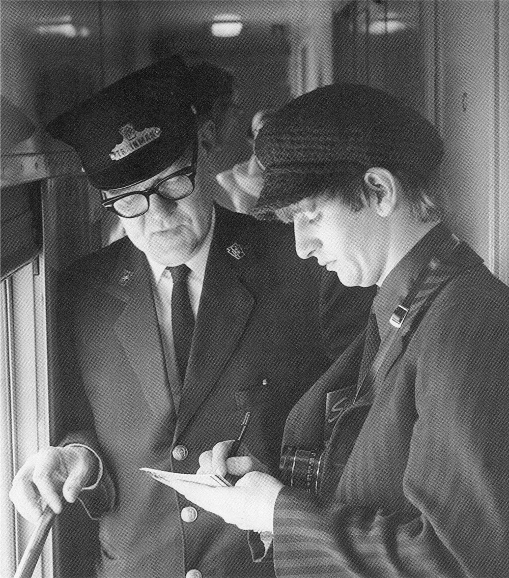 Ringo Starr signing an autograph for a train conductor, 1964.