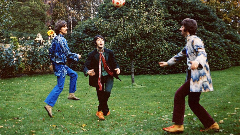 The Beatles playing football, circa 1967.