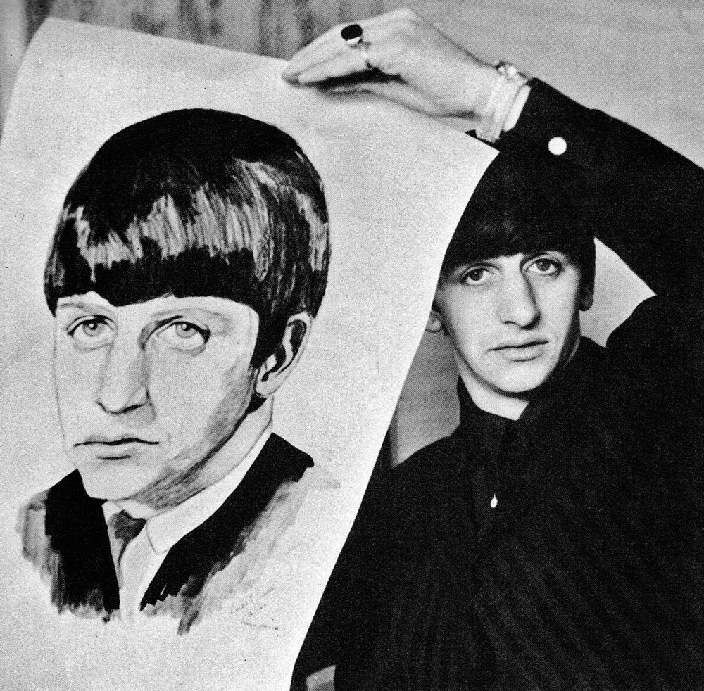 Ringo Starr holding up a portrait, circa 1964.