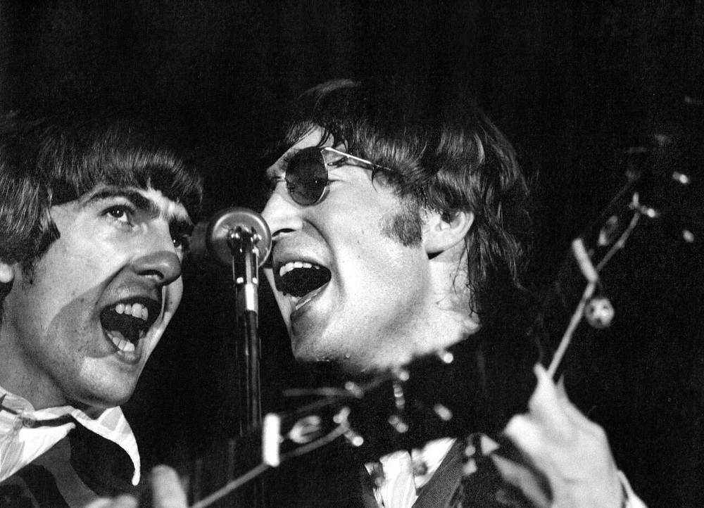 John Lennon and George Harrison, live 1966.