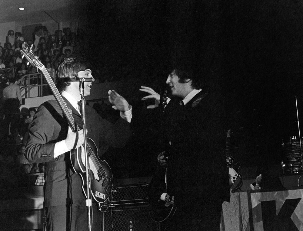 John Lennon and Paul McCartney on stage, circa 1964.