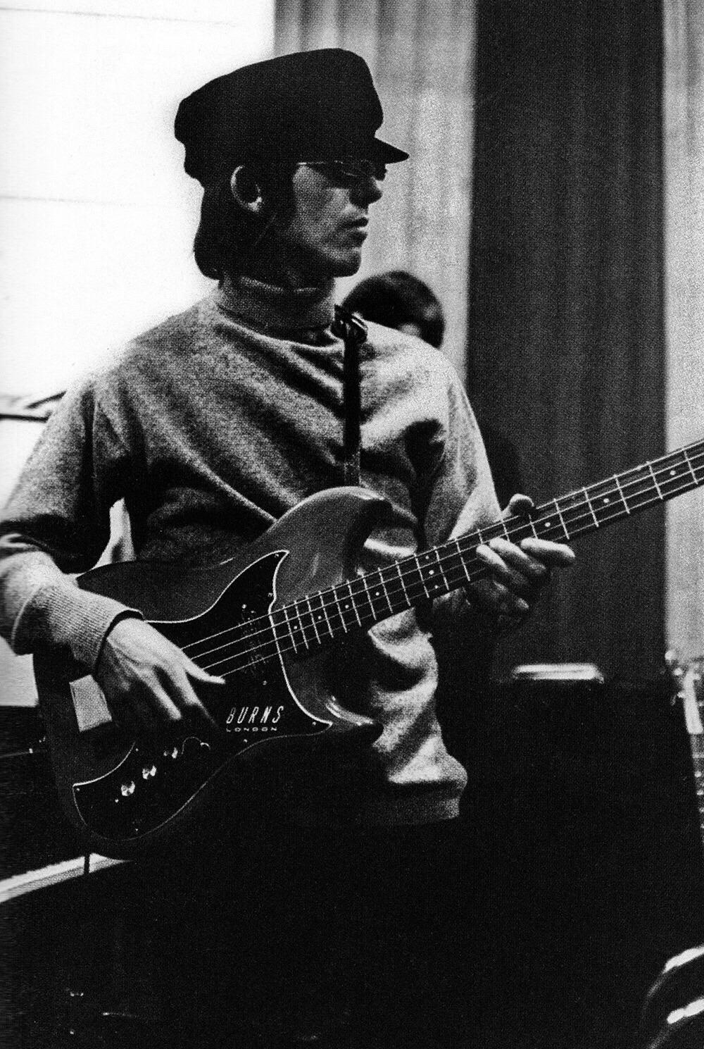 George Harrison playing bass at a rehearsel for John Lennon's Rain, April 1966.