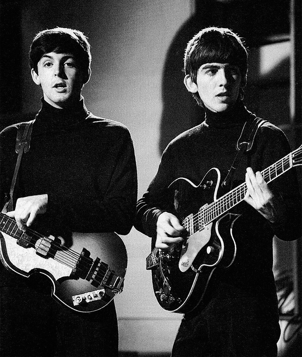 Paul McCartney and George Harrison, circa 1963.