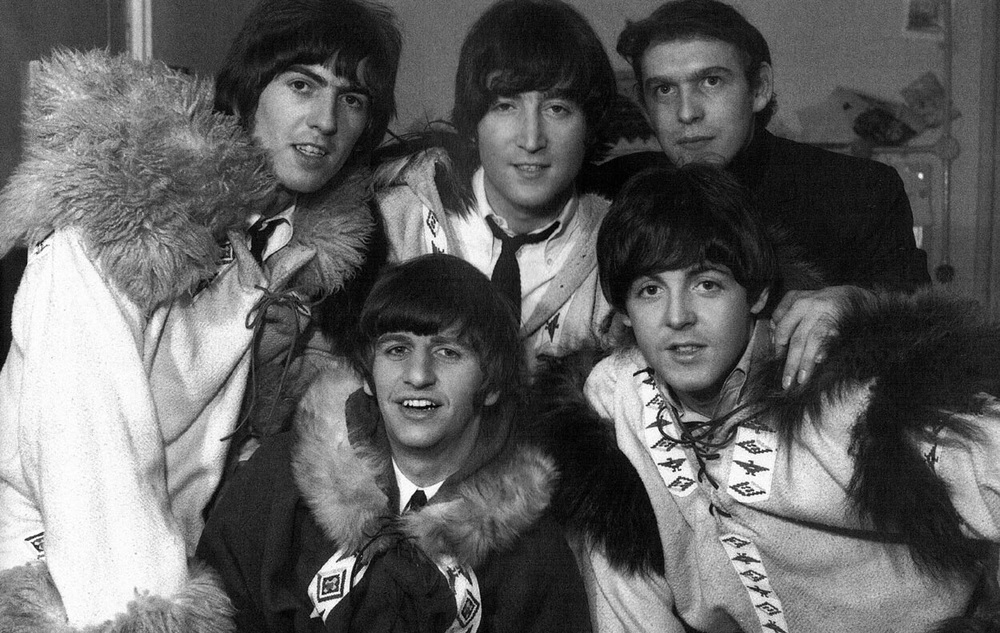The Beatles with Road Manager and childhood friend Neil Aspinall, circa 1965.