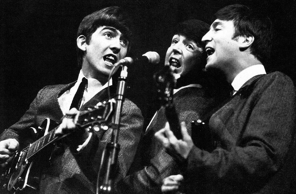 George Harrison, Paul McCartney and John Lennon singing harmonies, 1963.