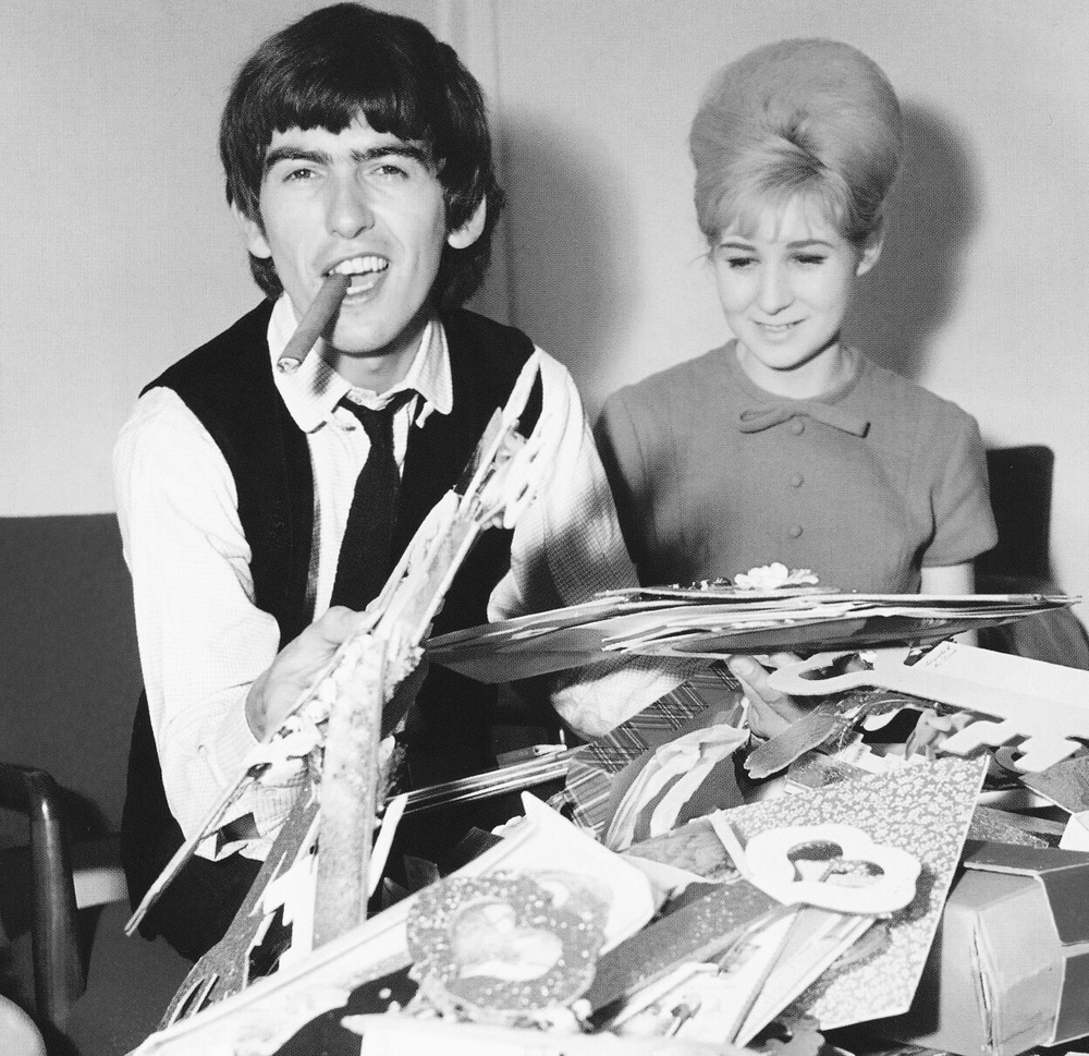 George Harrison celebrating his 21st birthday, February 25th, 1964.