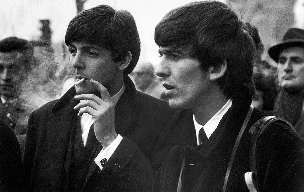 Paul McCartney and George Harrison in Paris, January, 1964.