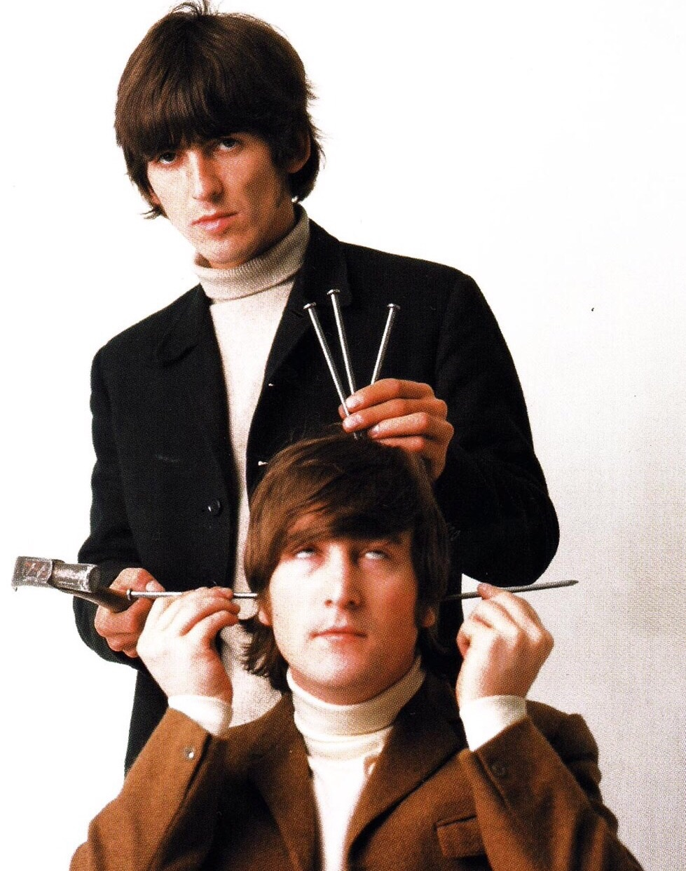 "John Lennon and George Harrison at the 1966 photo shoot for the ""Butcher"" cover."