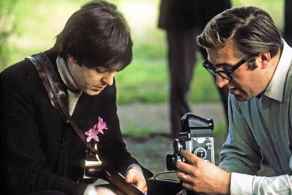 Paul McCartney with Mal Evans, circa 1966.