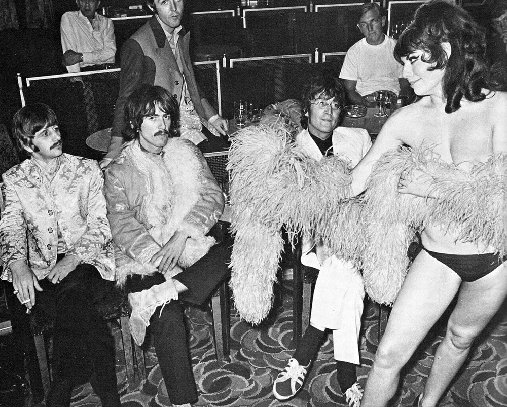 The Beatles with a nightclub dancer, 1967.
