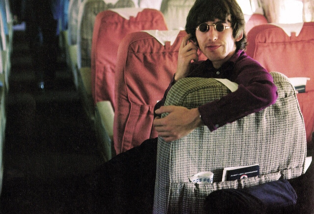 George Harrison travelling to Japan for The Beatles concerts at the Budokan Hall, 1966.