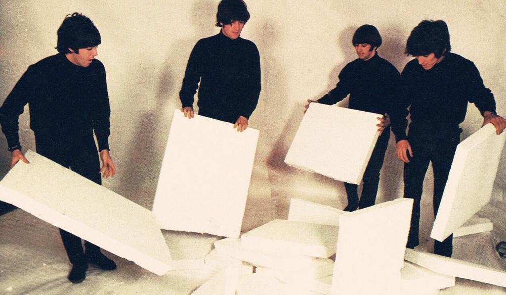 The Beatles at a photo shoot, circa 1965.