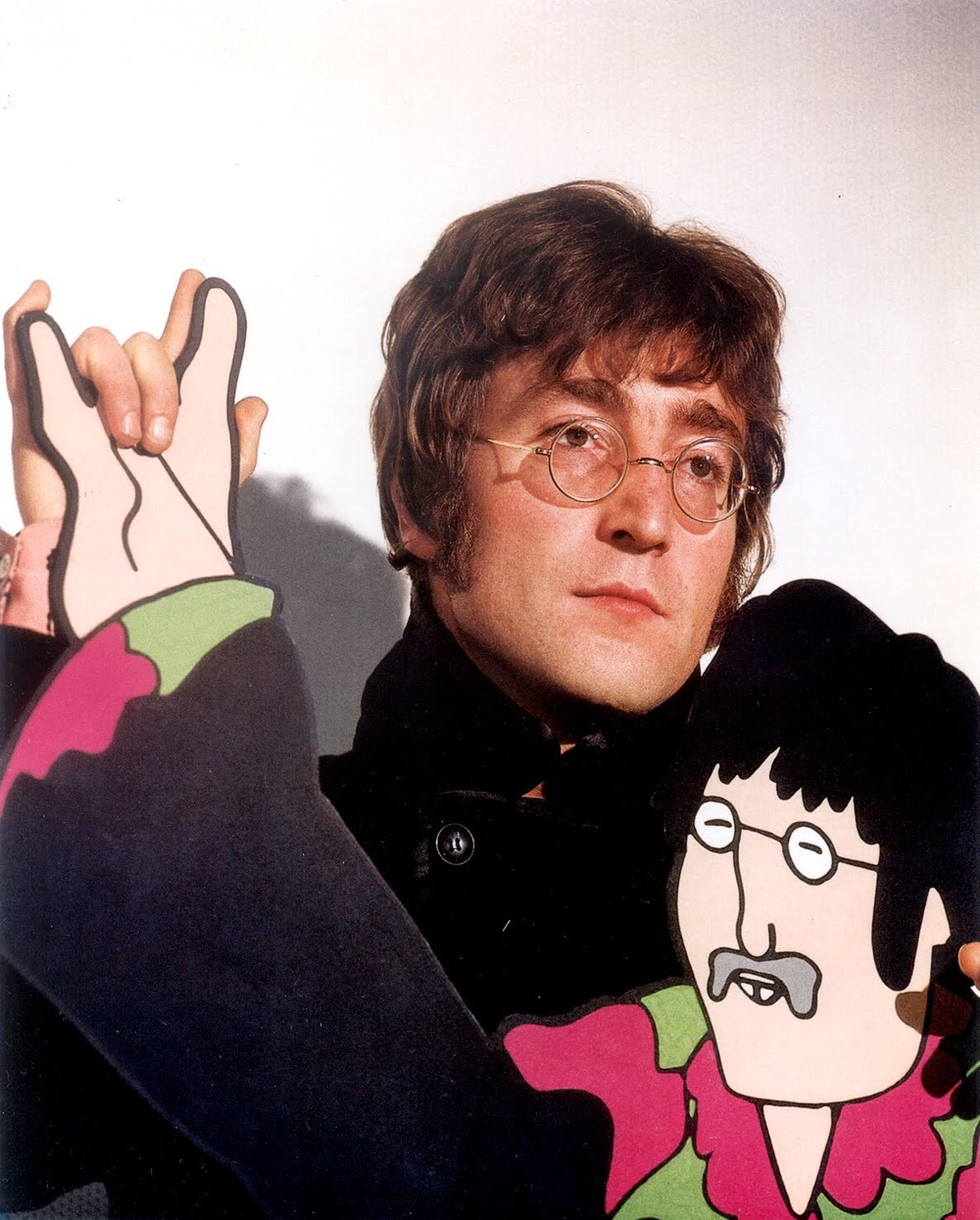 John Lennon  promoting Yellow Submarine with his cardboard cutout, 1968.