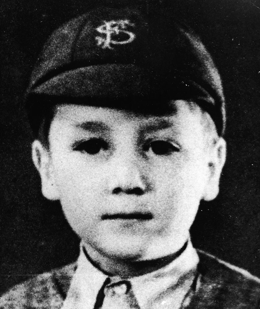 A young John Lennon sporting a San Francisco cap.