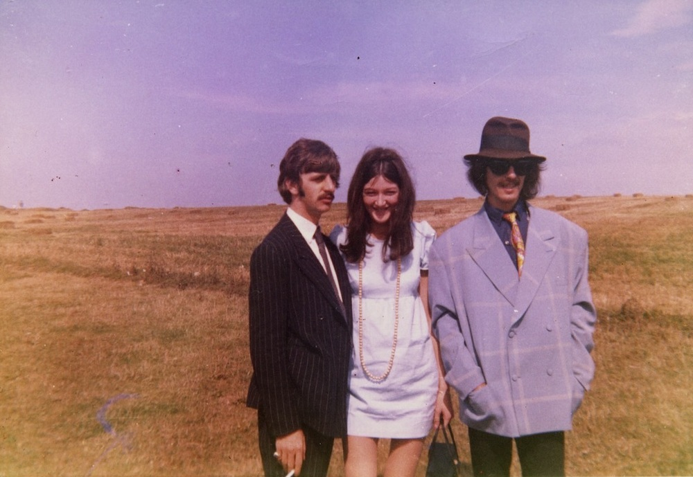 Ringo Starr and George Harrison with the Beatles' fan club secretary Freda Kelly, 1967.