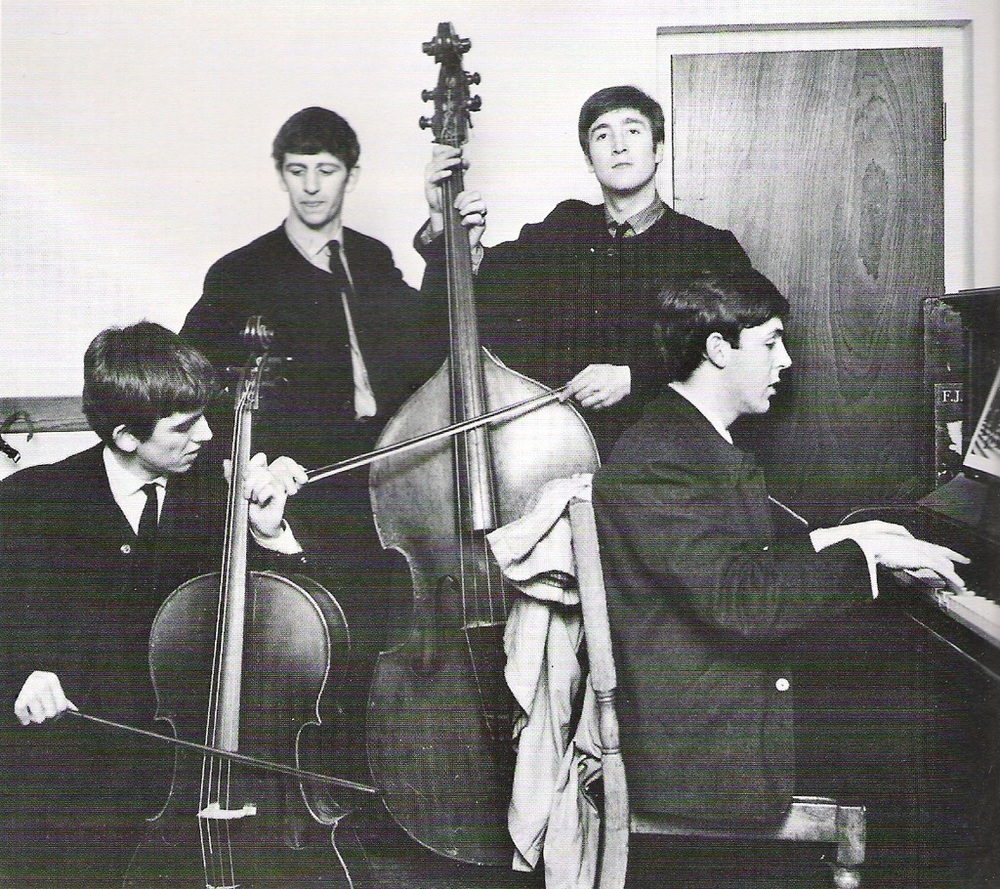 The Beatles playing various instruments in 1963. Photo by Dezo Hoffman.
