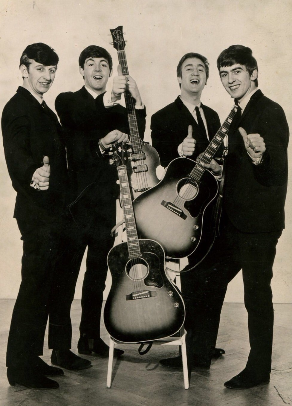 The Beatles posing with their guitars, circa 1962. Photo by Dezo Hoffman.