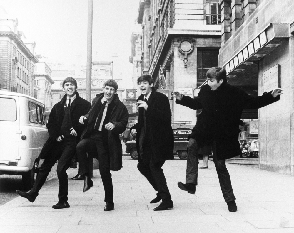 The Beatles goofing around outside the BBC, London, circa 1963.