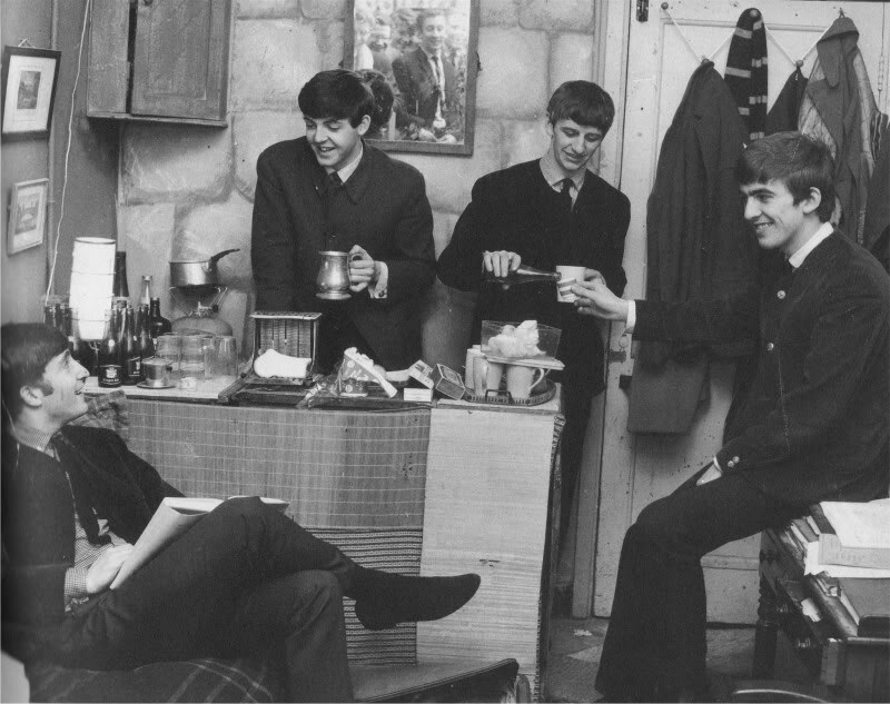 The Beatles enjoying some refreshment. Photo by Dezo Hoffman, circa 1963.