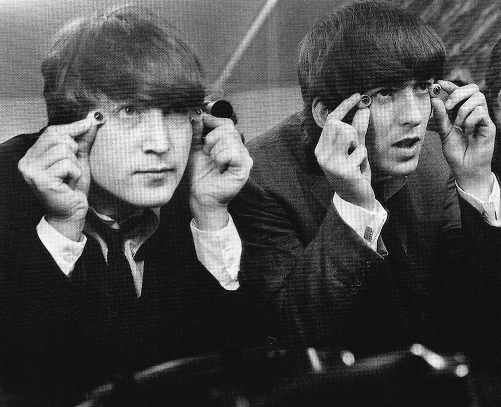 John Lennon and George Harrison at Madame Tussauds, London, April 1964.