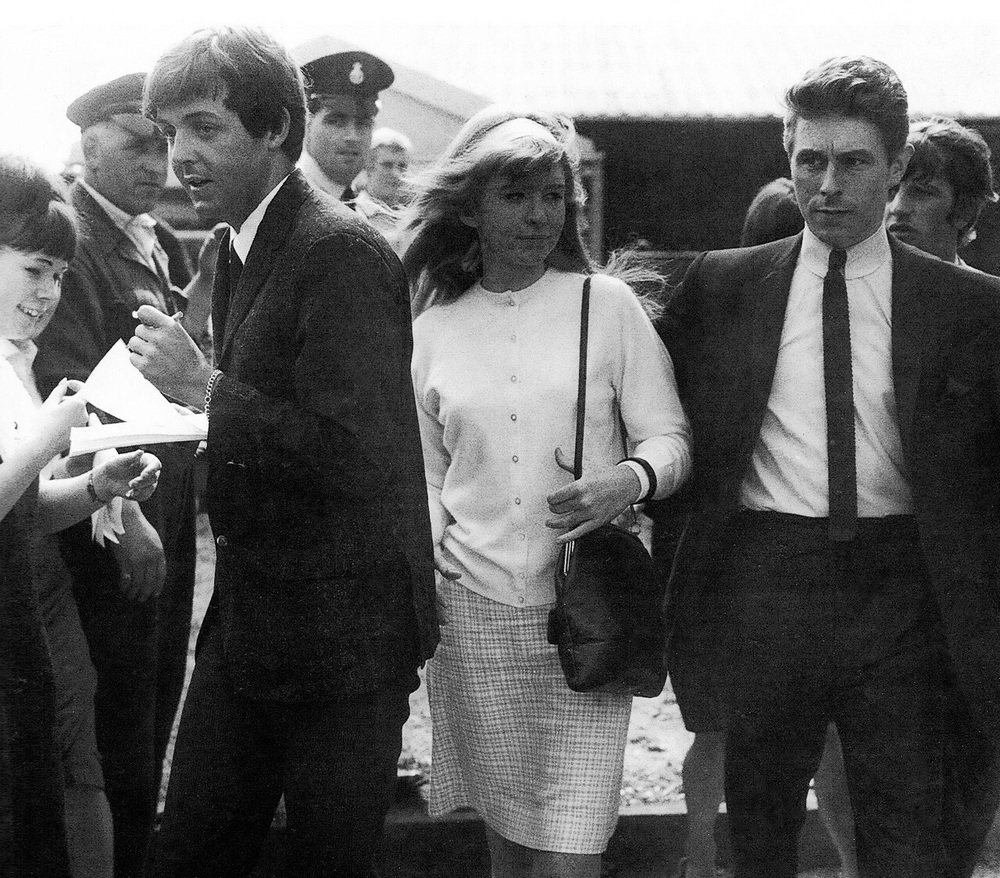 P aul McCartney signing autographs with Jane Asher and Derek Taylor, circa 1964.