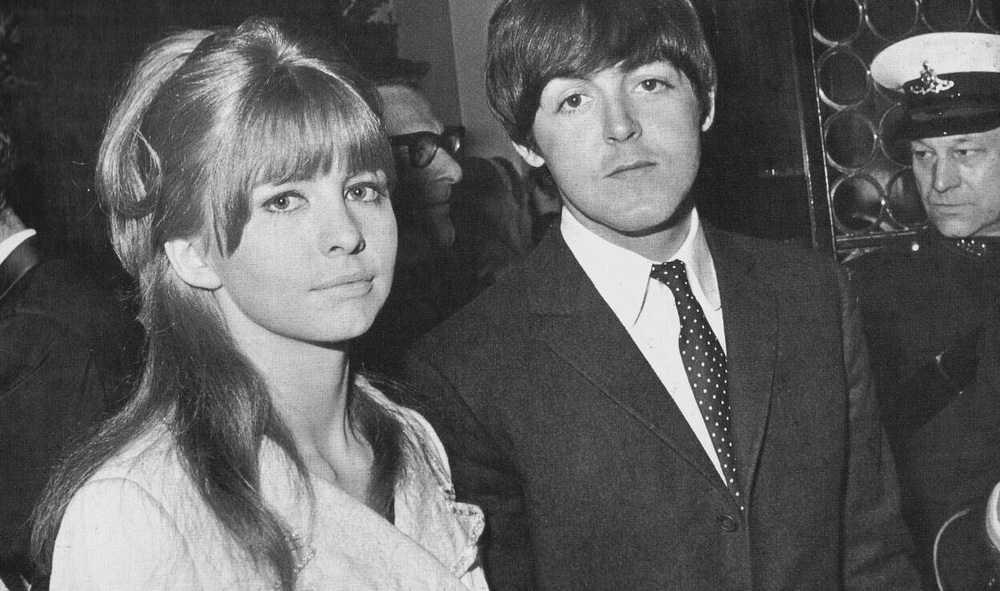 Paul McCartney and Jane Asher not too happy to be having their picture taken, circa 1965.