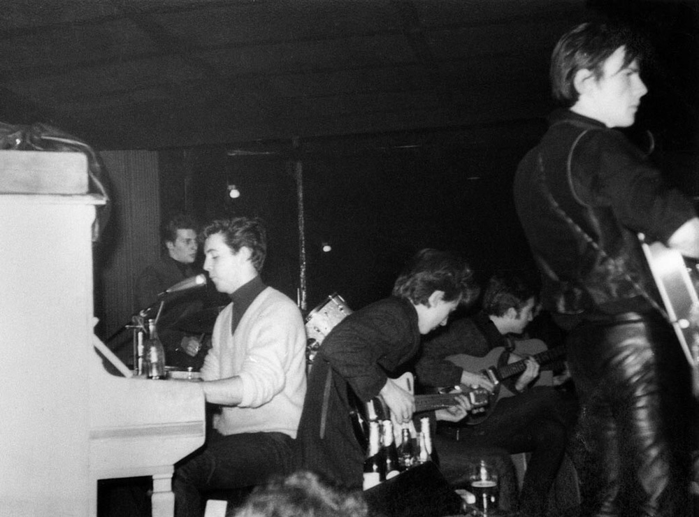 The Beatles performing in Hamburg, 1960.