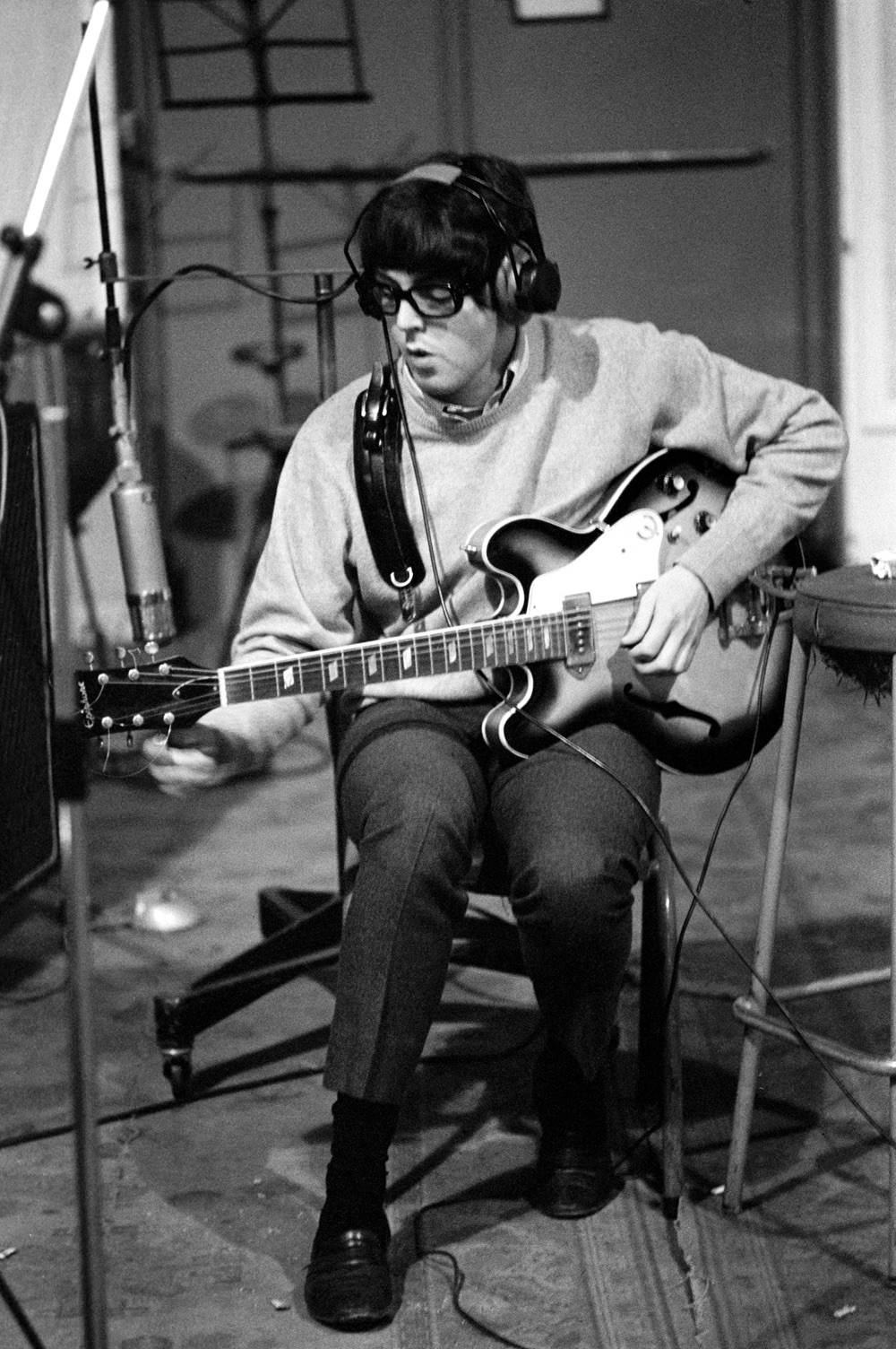 Paul McCartney tuning up for another take, recording Revolver, 1966.
