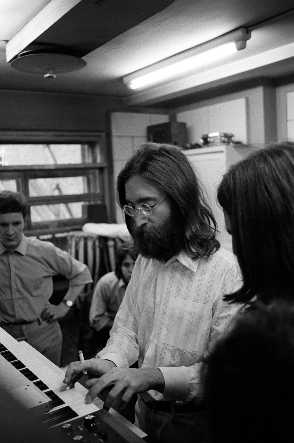 John Lennon playing a moog during an Abbey Road session, 1969.