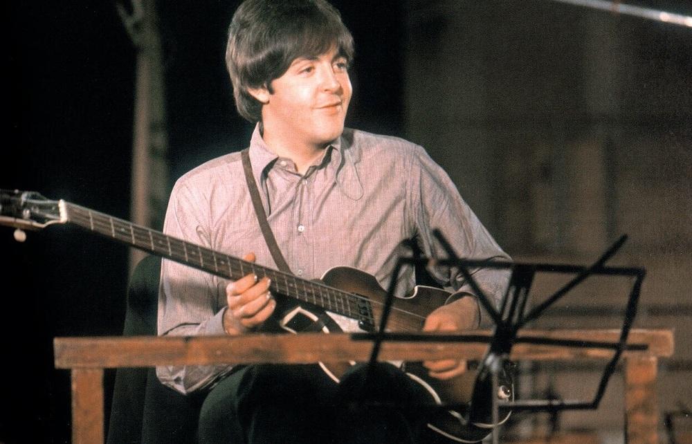 Paul McCartney playing his Hofner bass, 1966.