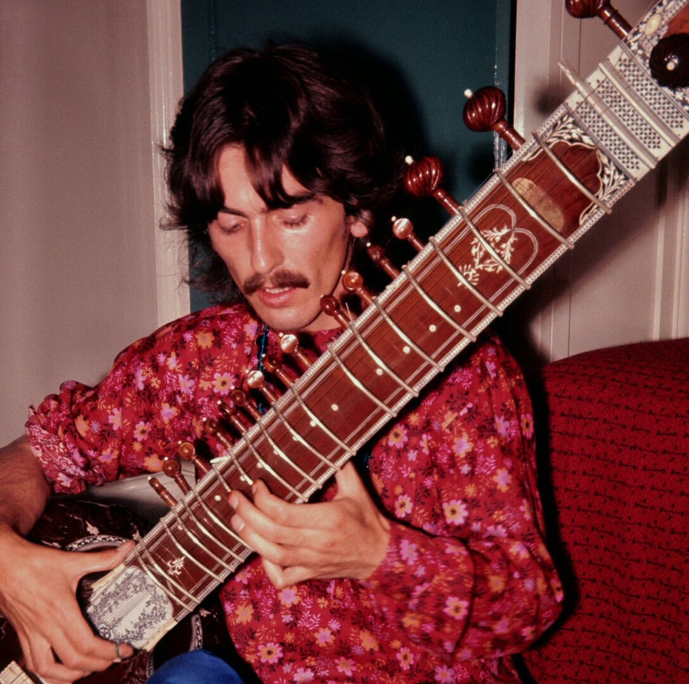 George Harrison playing a sitar, circa 1967.