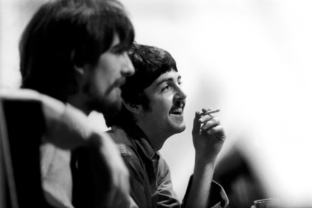 George Harrison and Paul McCartney taking a cigarette break during the recording of Sgt. Pepper, 1967.